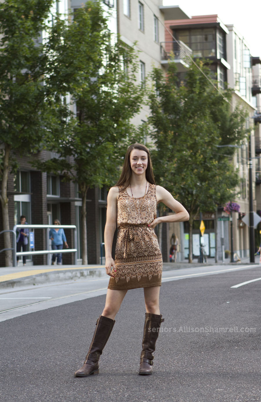 A high school senior in Portland, Oregon stands in downtown streets.