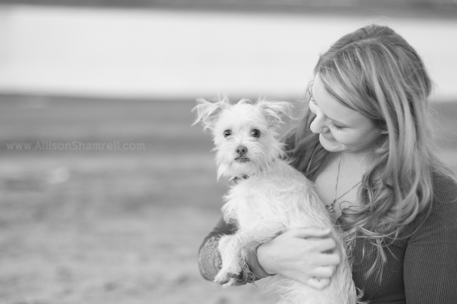 girl holding dog